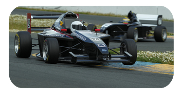 3 wide through turn 1 at Infineon Raceway at the Indy GP of Sonoma